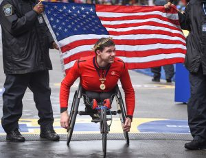 Daniel Romanchuk of the United States wins the men's elite wheelchair division at the 2019 Boston Marathon
