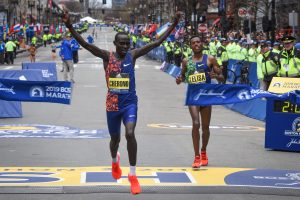 Lawrence Cherono of Ethopia crosses the finish line as the men's elite champion at the 2019 Boston Marathon