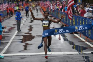 Monicah Ngige of Kenya crosses the finish line as the 2019 BAA 5K Womans Champion